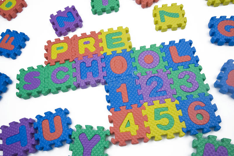 Preschool and Numbers. Written in foam letters on white background royalty free stock photos