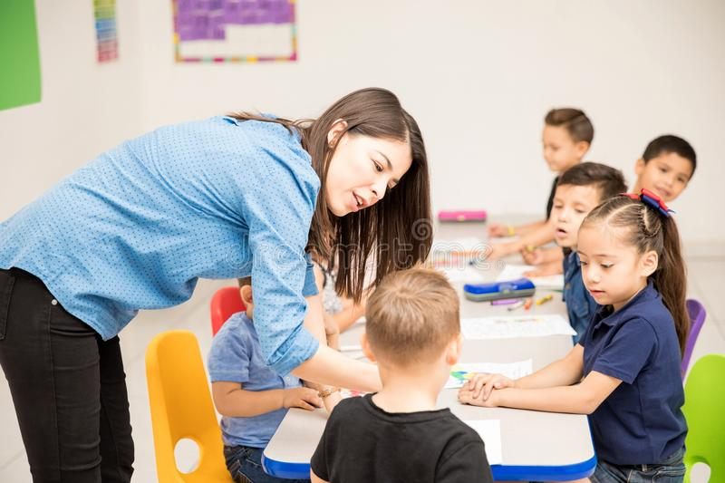 Preschool teacher with some of her students royalty free stock image