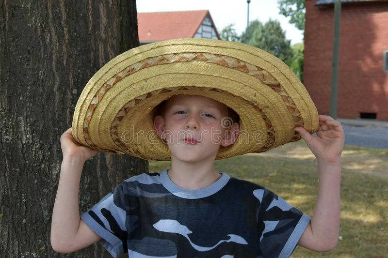 Preschooler with big mexican straw hat royalty free stock images