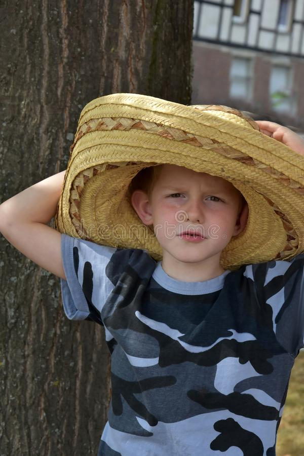 Preschooler with big mexican straw hat royalty free stock photo