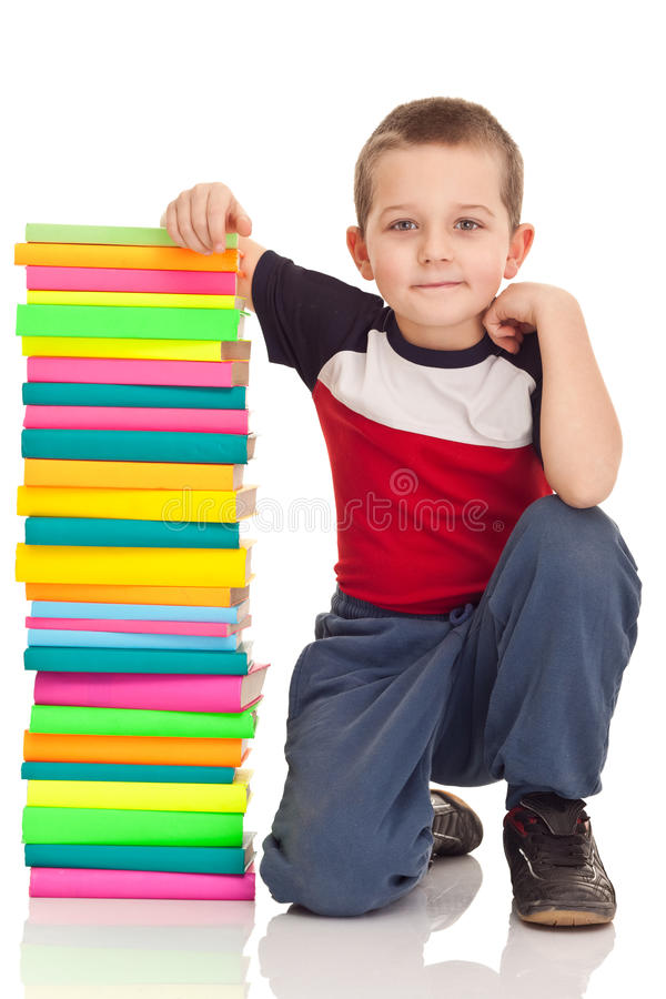 Preschooler and big stack books stock photography