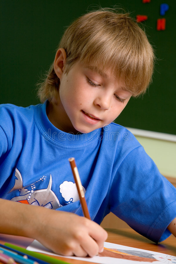 Preschooler boy draw royalty free stock photos