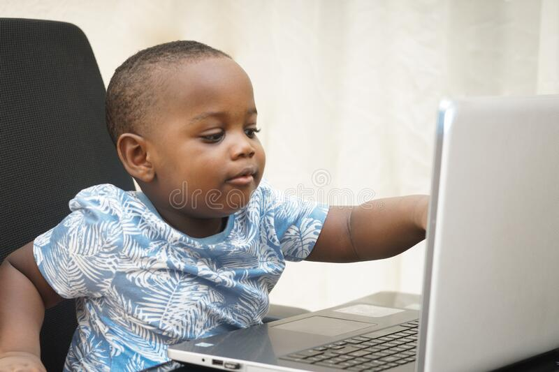 Preschooler e-learning online at home with a laptop stock images