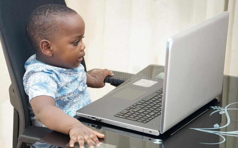Preschooler e-learning online at home with a laptop stock photography