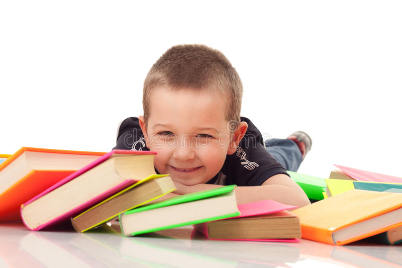 Preschooler with pile of books stock image