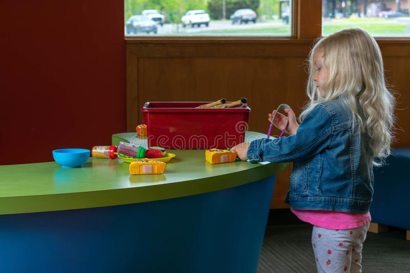 Preschooler playing with play food stock images