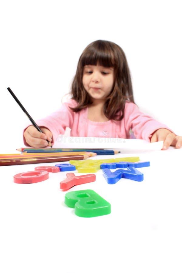 preschooler rysunkowy mały writing obraz stock