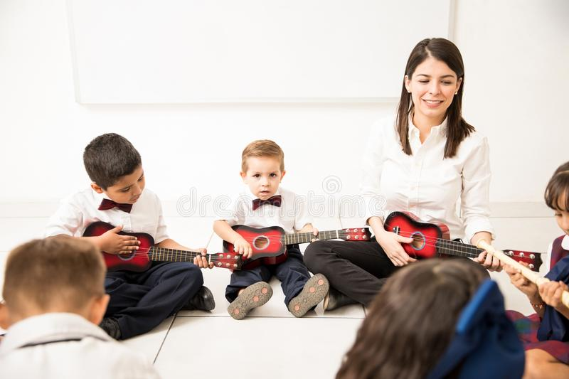 Group of kids learning music in preschool stock photos