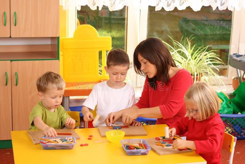 Preschoolers and wooden blocks stock photos