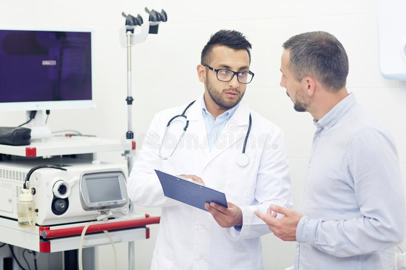Prescribe Treatment for Middle-aged Patient stock photography