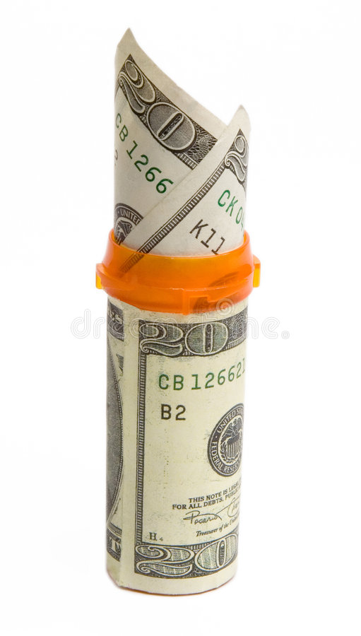 Prescription bottle with $20 bills isolated. royalty free stock photo