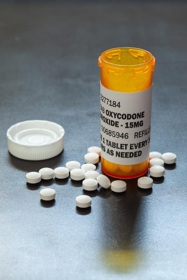 Prescription bottle with backlit Oxycodone tablets. Oxycodone is a generic prescription opioid. royalty free stock image