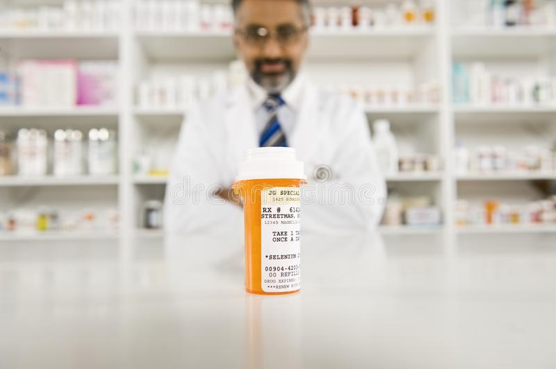 Prescription Drugs And Male Pharmacist royalty free stock photography