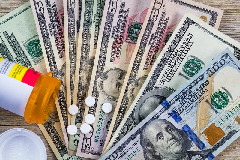 Prescription drugs in the USA are expensive, concept, Rx on US dollars, flat lay. Medicare, medicaid, mandate stock images