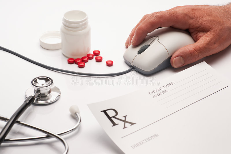Prescription medicine and computer mouse royalty free stock photo