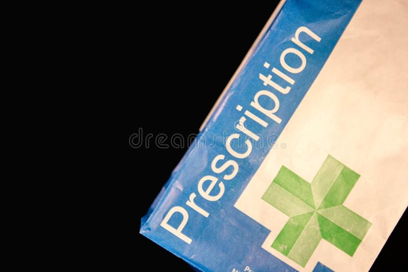 Prescription paper bag on a black background stock images