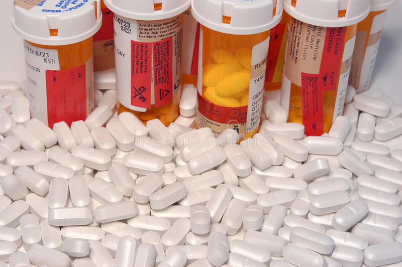Prescription pills and pill bottles royalty free stock photography