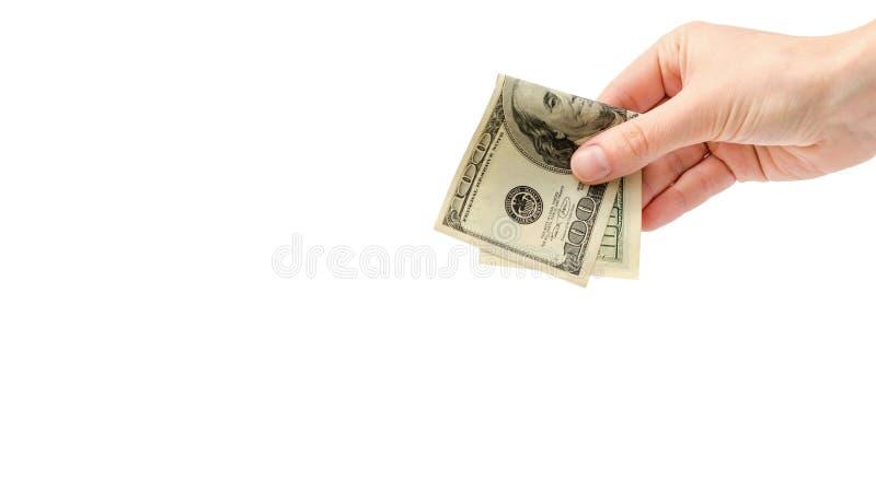 Prese o elasticità femminili della mano cento dollari americani Isolato su priorità bassa bianca copi lo spazio, modello fotografia stock