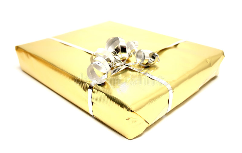 Present. A golden present on an isolated white background stock photo