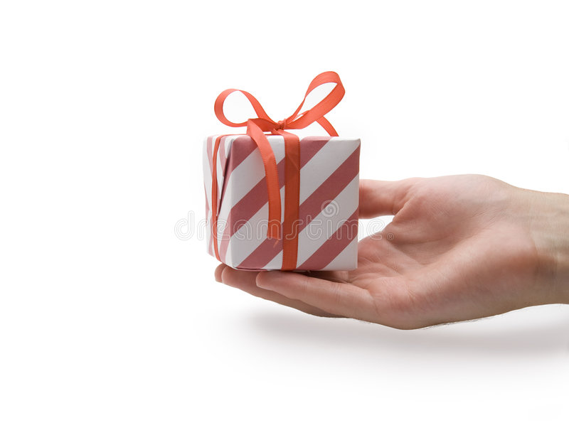 Present. Hand down red present on white background stock photo