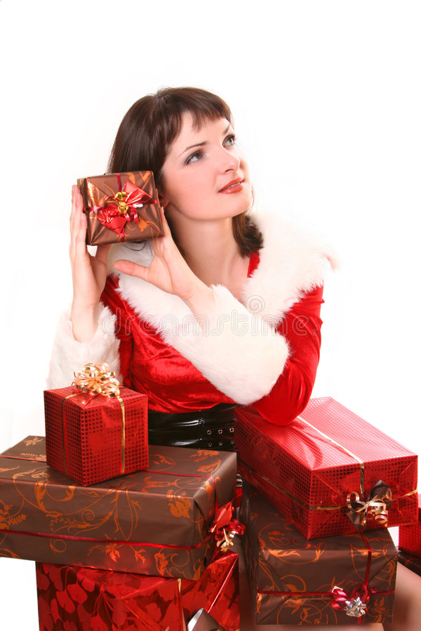 Present. Young Santa-girl with presents royalty free stock photography