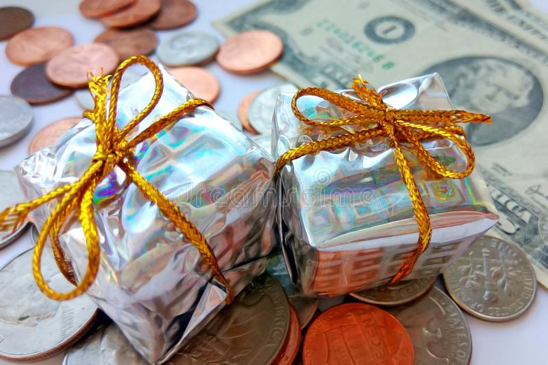 Present box with American coins with dollar usa background. New Year gift with money royalty free stock photos