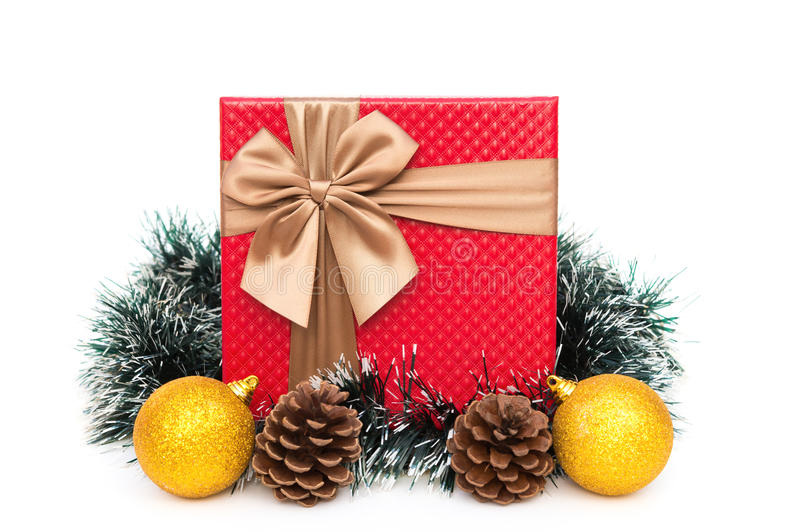 Present box with christmas decoration on white background stock photos