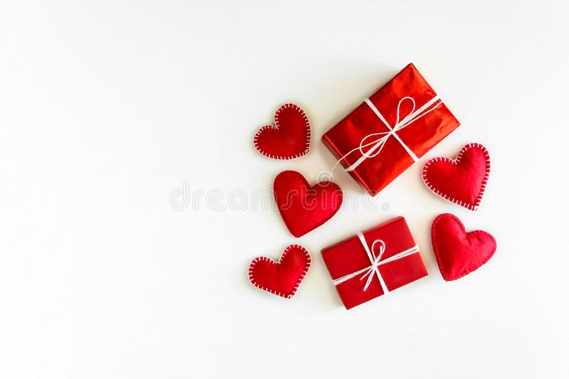 Present box with felt love hearts on white wooden background. Valentine`s day celebration concept. Top view. Flat lay royalty free stock photo