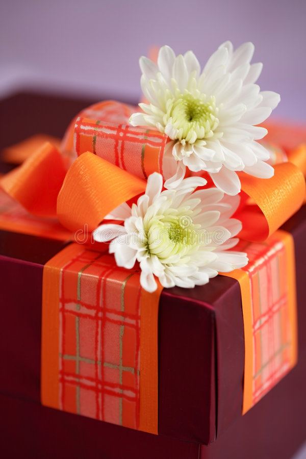 Present box with flowers stock photos