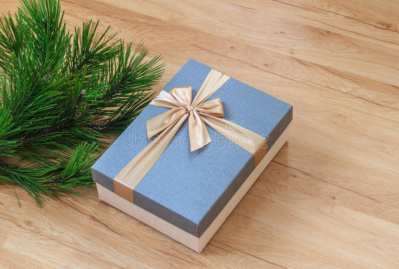 Present box near pine tree stock image