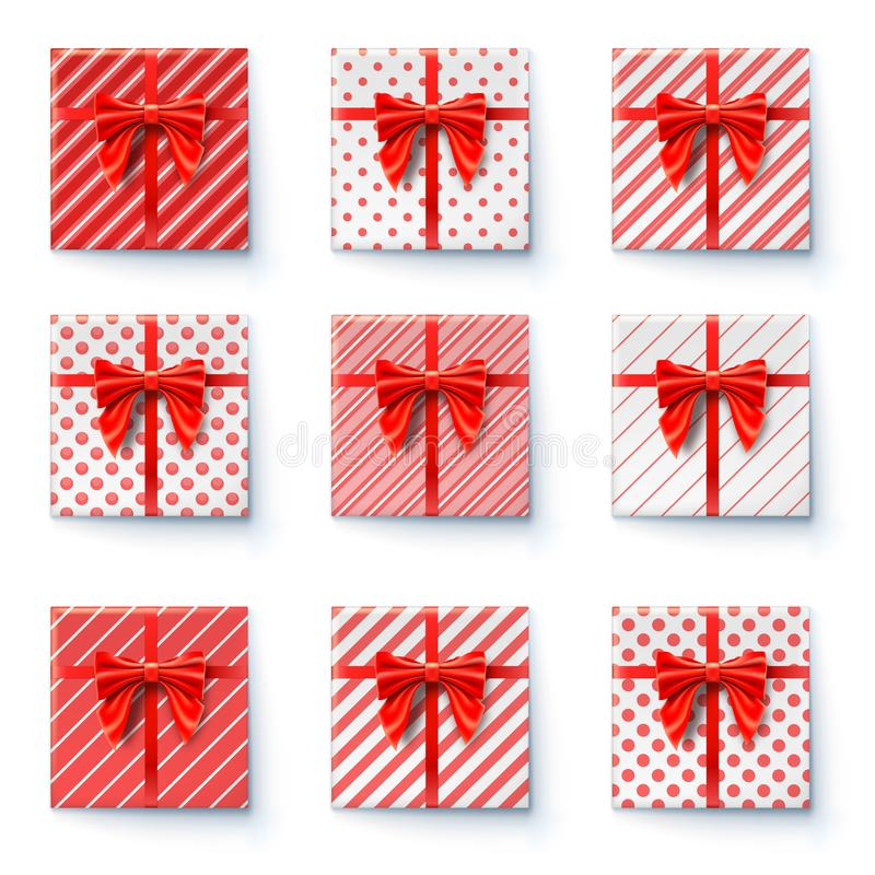Present boxes with red ribbon and big bow isolated on white background. Top view on gift boxes, festive packaging stock illustration