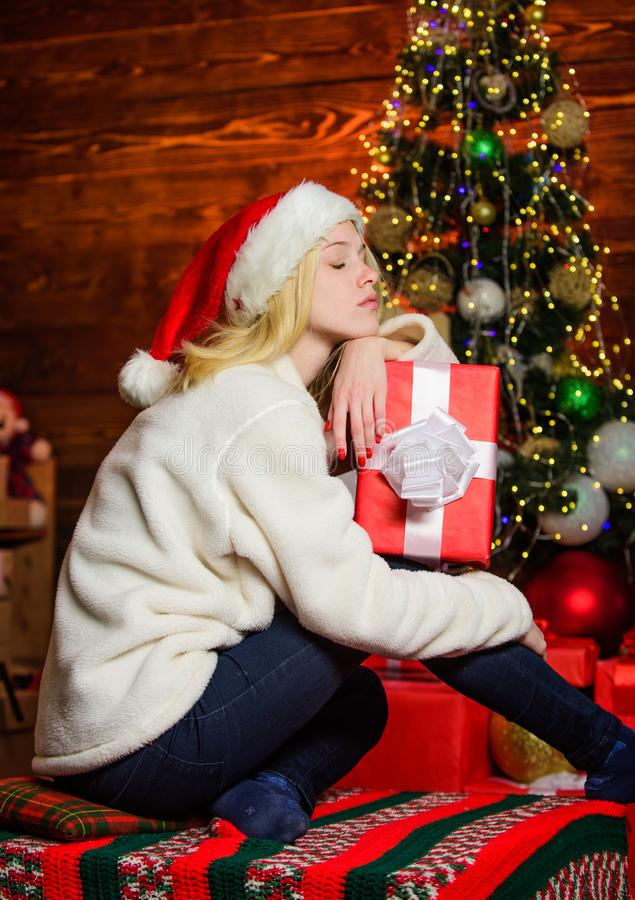 Present concept. Boxing day. New year is coming. Christmas eve. Lonely sad woman and christmas gift box. Nostalgic royalty free stock photography