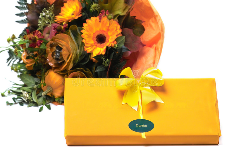 Present and flowers stock photography