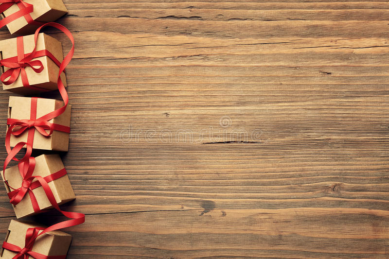 Present Gift Box on Wood Background, Holiday Cardboard Boxes over Grunge Wooden Texture stock photography