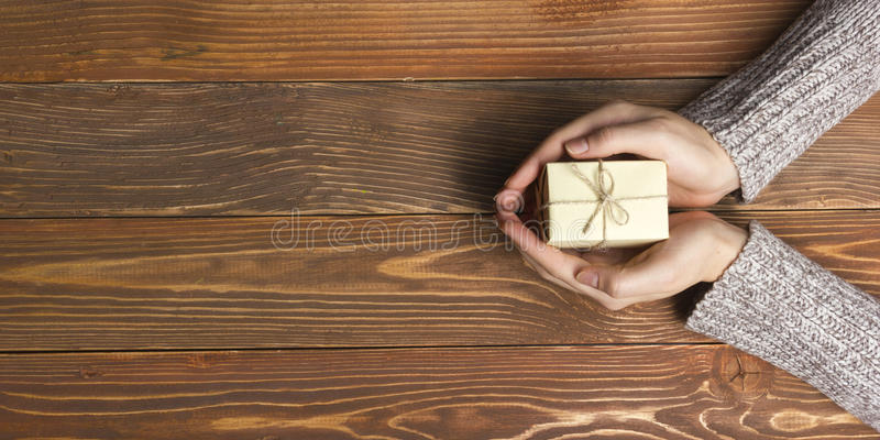Present, gift. Close up of female hands holding royalty free stock image