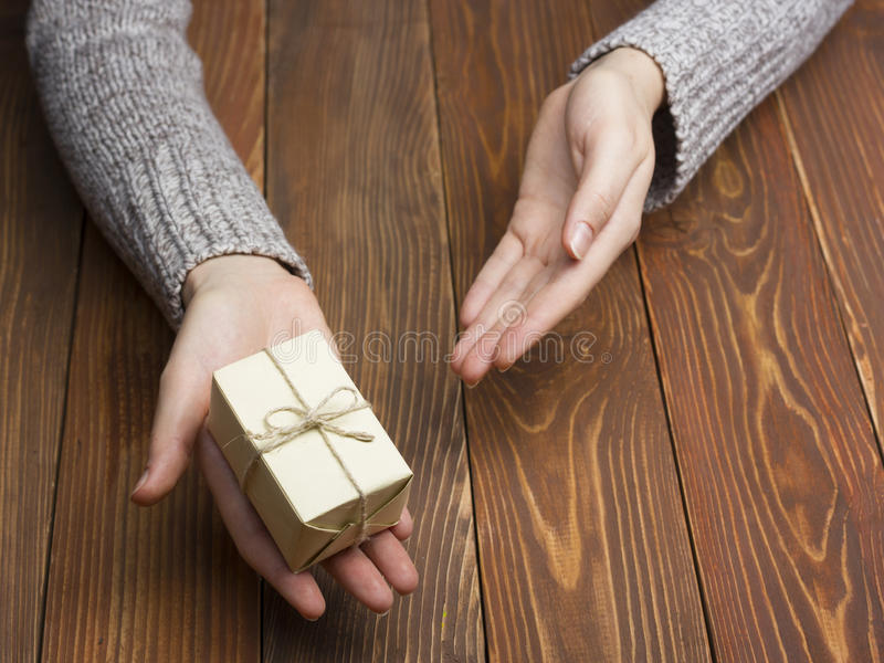 Present, gift. Close up of female hands holding small gift royalty free stock photo