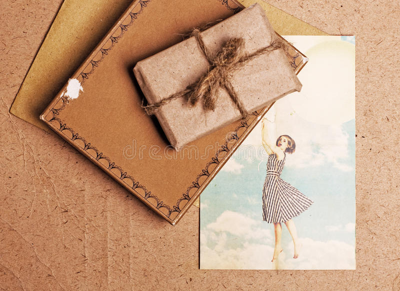 Present gift from grunge paper. And postcard stock photo