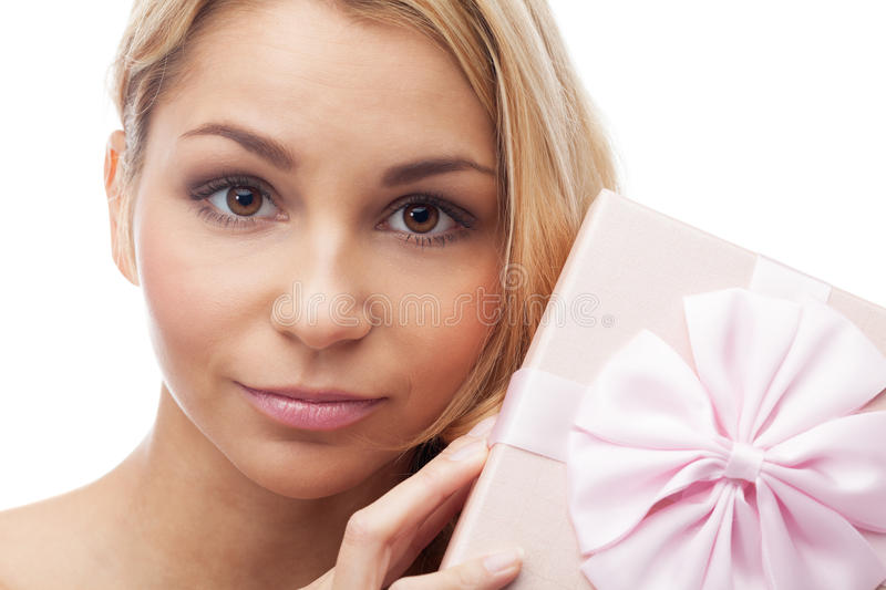 Present for me?. Girl with present on isolated white stock photo