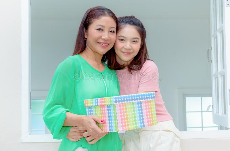 Present for mom,happy mother and young daughter hold present for stock images
