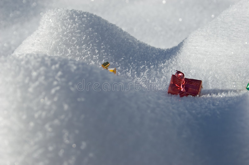 Present in the snow. Gifts in the snow during winter stock image