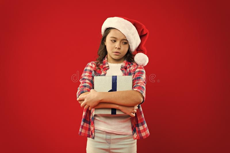 Present for Xmas. Childhood. Christmas shopping. New year party. Santa claus kid. Little girl child in santa red hat royalty free stock photos