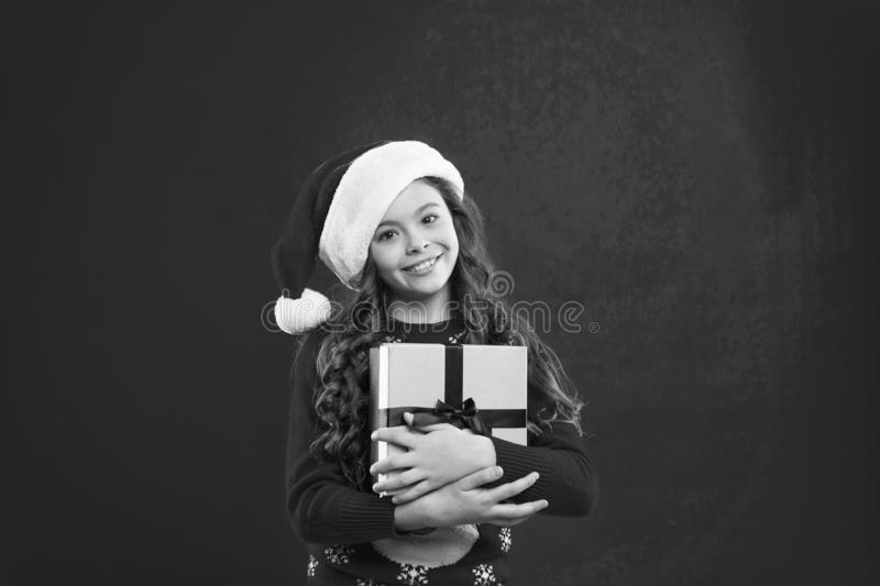Present for Xmas. Happy New 2019 Year. Childhood. Happy winter holidays. Small girl. New year party. Santa claus kid royalty free stock image