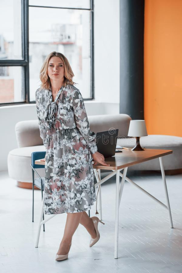 Free Presentable Look. Businesswoman With Curly Blonde Hair Standing In Room Against Window Stock Images - 166597914