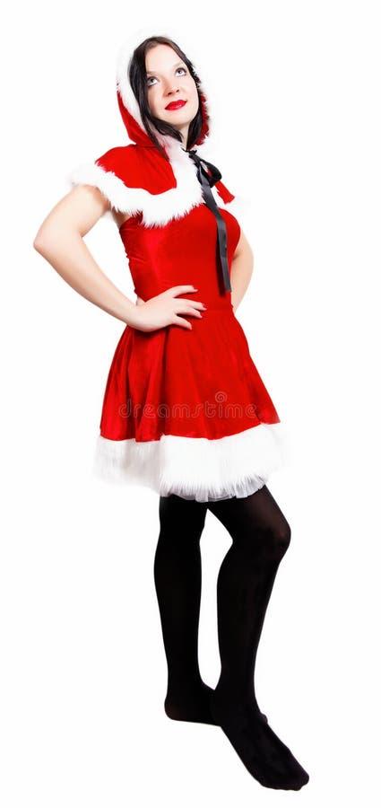 Presentación agradable de la muchacha vestida como Navidad de Santa imagen de archivo libre de regalías