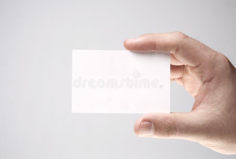 Presentación de una tarjeta de visita blanca imagen de archivo libre de regalías