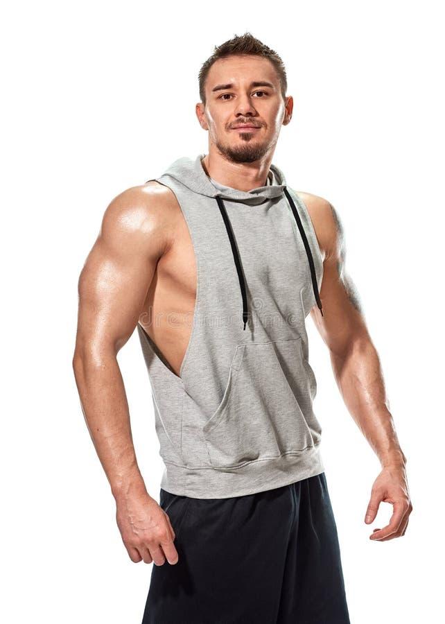 Presentación hermosa muscular del hombre joven imagen de archivo