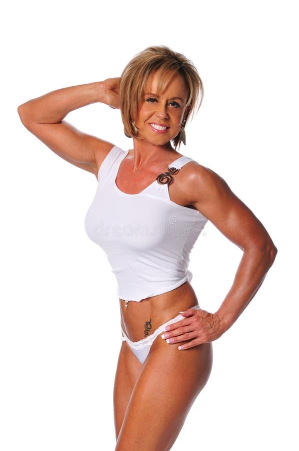 Presentación muscular de la mujer foto de archivo libre de regalías