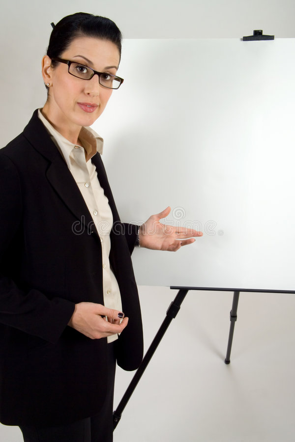 Presentation. Female presenter with blank presentation whiteboard royalty free stock photo