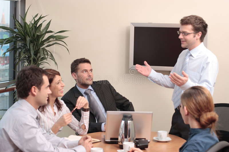 Presentation, five people royalty free stock image