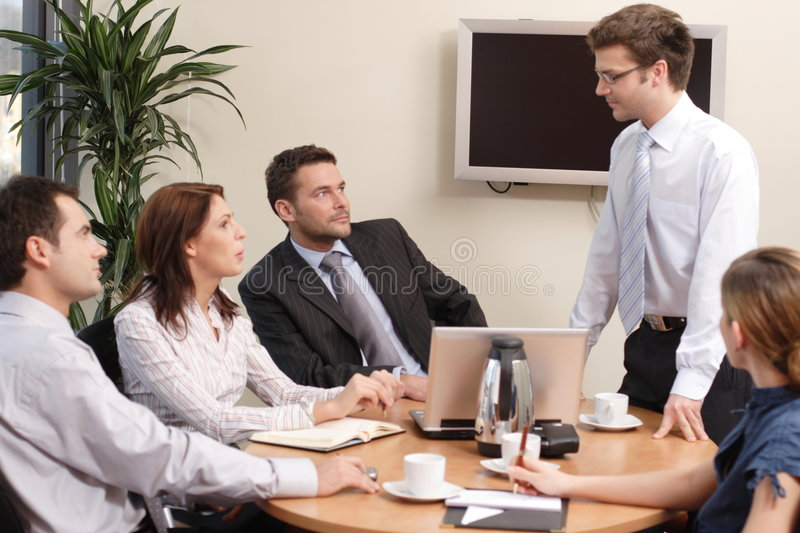 Presentation, five people stock photography